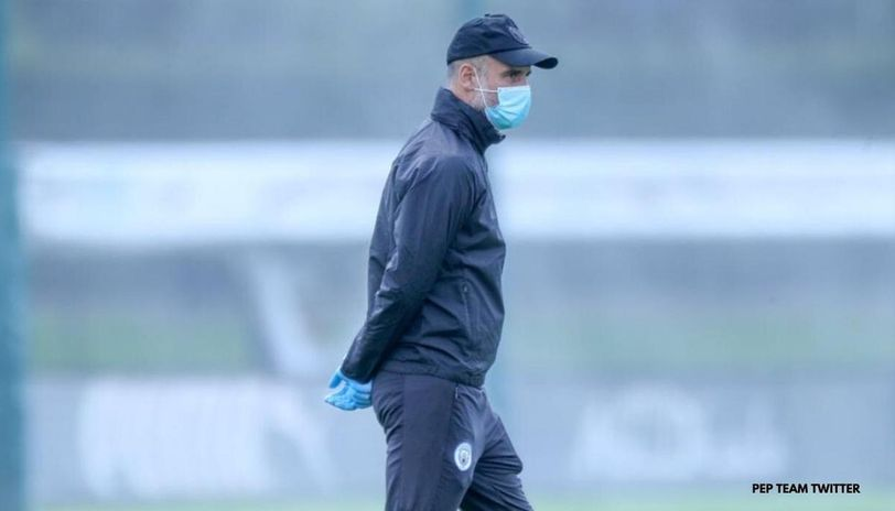 Pep Guardiola seen wearing PPE during a Manchester City training session.